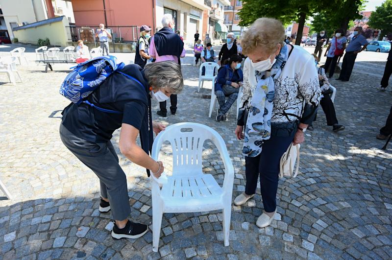 TURIN, ITALY - MAY 24: Chairs are sanitized ahead of the first mass celebrated by the parish priest Don Carlo Chiomento, of the Community of Candiolo, after more than two months of lockdown in which worshippers could not attend religious services on May 24, 2020 in Turin, Italy. Restaurants, bars, cafes, hairdressers and other shops have reopened, subject to social distancing measures, after more than two months of a nationwide lockdown meant to curb the spread of Covid-19. (Photo by Diego Puletto/Getty Images) (Photo: Diego Puletto via Getty Images)