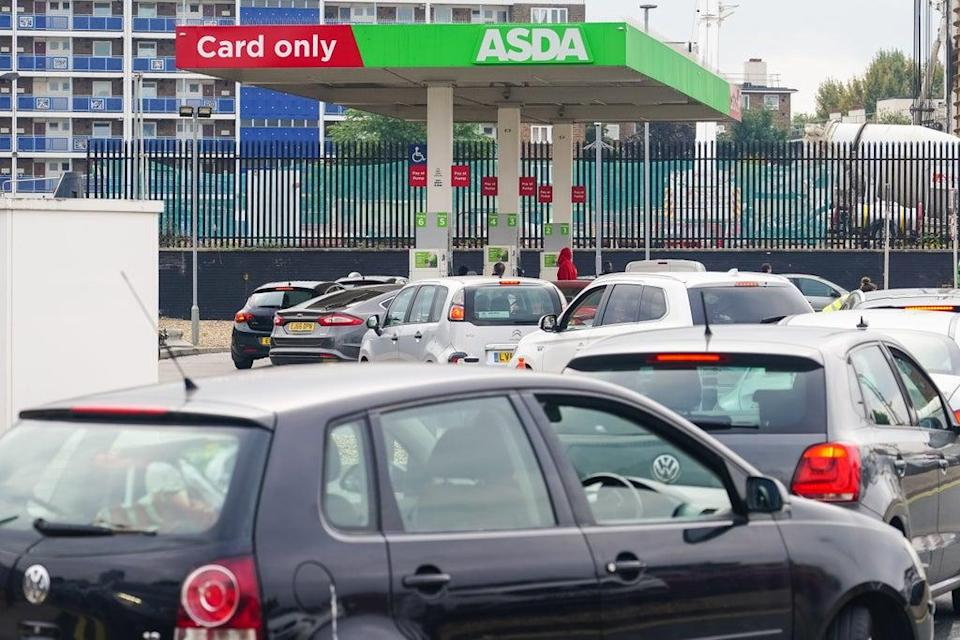Cars queue for fuel at an Asda petrol station in south London amid continued panic buying (Dominic Lipinski/PA) (PA Wire)