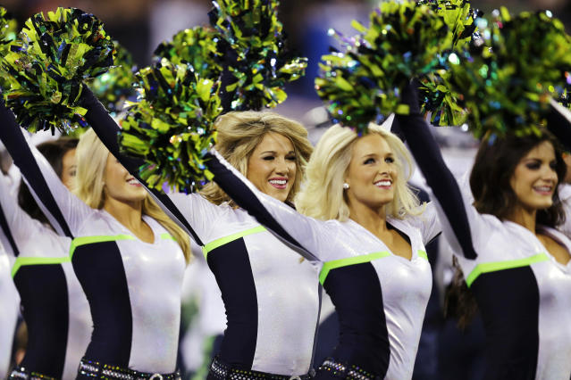 Seattle Seahawks cheerleaders perform before the NFL Super Bowl XLVIII football game against the Denver Broncos Sunday, Feb. 2, 2014, in East Rutherford, N.J. (AP Photo/Ben Margot)