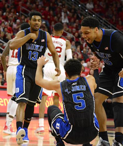 Jahlil Okafor (15) reacts to a defensive play by guard Tyus Jones (5) against NC State. (Rob Kinnan-USA TODAY Sports)