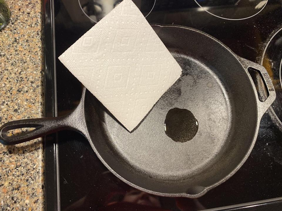 """<p>After washing you will want to completely dry the skillet to ensure no water is left behind. Water is the enemy of <a href=""""https://www.popsugar.com/food/Easiest-Way-Clean-Cast-Iron-Pan-43350768"""" class=""""link rapid-noclick-resp"""" rel=""""nofollow noopener"""" target=""""_blank"""" data-ylk=""""slk:cast iron"""">cast iron</a> and will cause the skillet to rust. Use a paper towel and a small amount of oil to reseal the skillet. This is best done while the pan is still hot so the oil can get down into the pores of the cast iron and not just sit on top. Buff away any excess oil with a new paper towel.</p>"""