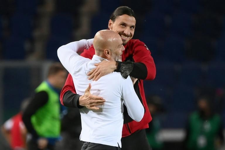 Coach Stefano Pioli (L) celebrates with Zlatan Ibrahimovic after AC Milan finished second in Serie A.