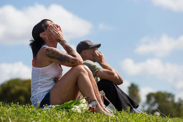 <p>Stacey Sindon, 51, reacts as she mourns in front of Marjory Stoneman Douglas High School in Parkland, Fla. on Sunday, Feb. 18, 2018. A gunman entered the school last Wednesday and killed 17 students and teachers. (Photo: Matias J. Ocner/Miami Herald/TNS via Getty Images) </p>