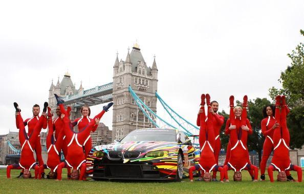 LONDON, ENGLAND - JULY 3: Elizabeth Streb's dancers perform during the launch of BMW Art Car at Potters Field on July 3, 2012 in London, England. (Photo by Jan Kruger/Getty Images for BMW)