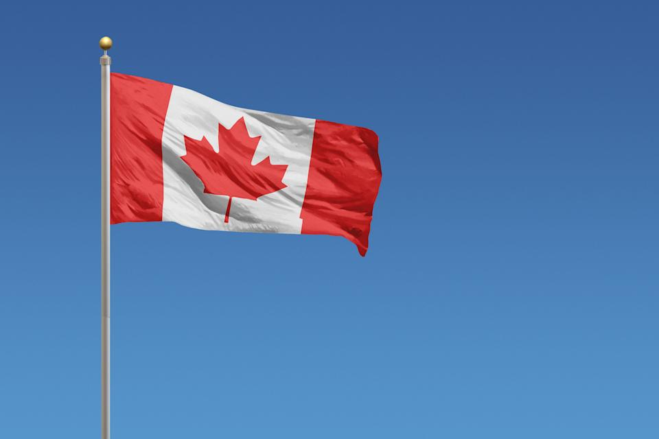 A Canadian flag on a flagpole.  (Photo: Derek Brumby via Getty Images)