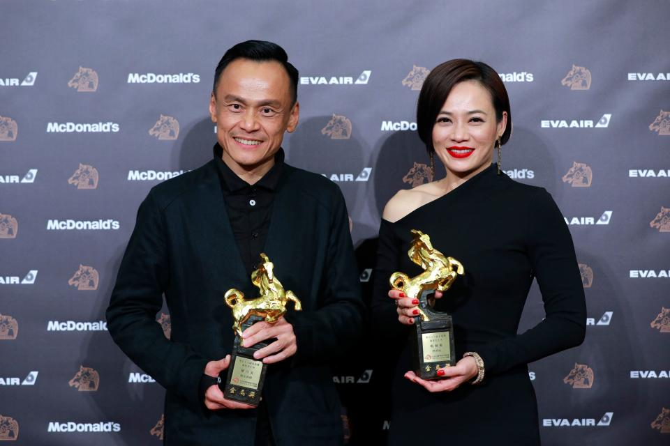 Taiwanese actor CHEN Yi-wen and Malaysian actress YEO Yann-yann pose with their trophy at the 56th Golden Horse film awards, dubbed the Chinese 'Oscars', in Taipei on November 23, 2019. (Photo by Daniel Shih / AFP) (Photo by DANIEL SHIH/AFP via Getty Images)