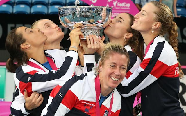 France celebrate with the Fed Cup - AFP or licensors