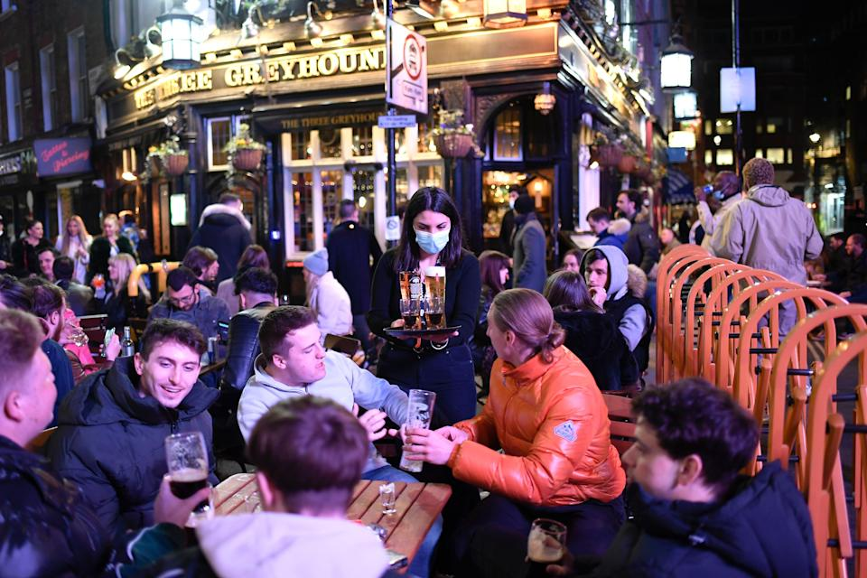 <p>People flocked to outdoor spaces at pubs as lockdown eased</p> (Copyright 2021 The Associated Press. All rights reserved)