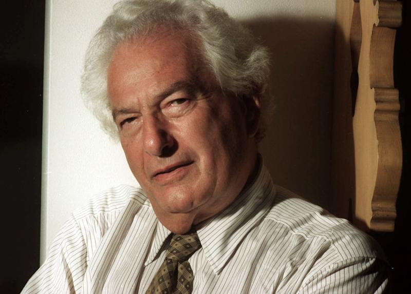 """FILE - In this Sept. 27, 1994 file photo, Joseph Heller the author of the classic anti-war novel """"Catch 22,"""" poses in New York. Heller's million-selling send-up of war and military bureacracy, one of the notable missing links in the digital library, was recently released electronically by Simon & Schuster and a 50th anniversary edition in hardcover and paperback next year. (AP Photo/Jim Cooper, file)"""