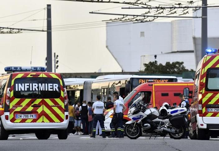 Emergency services are at work in Villeurbanne on the outskirts of Lyon, south-eastern France, after a knife attack (AFP Photo/PHILIPPE DESMAZES)