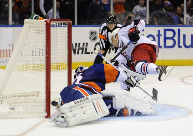 Columbus Blue Jackets' Cam Atkinson (13) shoots the puck past New York Islanders goalie Evgeni Nabokov (20) during an NHL hockey game on Saturday, Oct. 5, 2013, in Uniondale, N.Y. (AP Photo/Kathy Kmonicek)