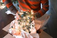 """<p>'Tis the season for <a href=""""https://www.marthastewart.com/1509835/thoughtful-ways-you-can-spread-little-holiday-cheer"""" rel=""""nofollow noopener"""" target=""""_blank"""" data-ylk=""""slk:spreading holiday cheer"""" class=""""link rapid-noclick-resp"""">spreading holiday cheer</a>, and few décor items enhance this festive time of year more than sparkling string lights. """"Christmas lights are a versatile way to get festive during the holiday season,"""" says Ashley Moore, the founder and principal designer at <a href=""""https://www.moorehouseinteriors.com/"""" rel=""""nofollow noopener"""" target=""""_blank"""" data-ylk=""""slk:Moore House Interiors"""" class=""""link rapid-noclick-resp"""">Moore House Interiors</a>. """"The decorating possibilities are endless with both indoor and outdoor lights—you can go all out, keep it simple, use colorful or classic white lights, keep them on the tree, or <a href=""""https://www.marthastewart.com/1504835/christmas-decorations"""" rel=""""nofollow noopener"""" target=""""_blank"""" data-ylk=""""slk:use them throughout your home"""" class=""""link rapid-noclick-resp"""">use them throughout your home</a>. Not to mention, they're the perfect budget-friendly option.""""</p> <p>Along with brightening up your Christmas tree, stairway rails, and <a href=""""https://www.marthastewart.com/905030/beautiful-fireplace-designs-inspire"""" rel=""""nofollow noopener"""" target=""""_blank"""" data-ylk=""""slk:fireplace mantel"""" class=""""link rapid-noclick-resp"""">fireplace mantel</a>, string lights can bring some holiday spirit to your home's exterior, too. """"Consider using them around your front porch, along your front doorway, or <a href=""""https://www.marthastewart.com/274364/holiday-wreaths"""" rel=""""nofollow noopener"""" target=""""_blank"""" data-ylk=""""slk:wrapped in a wreath"""" class=""""link rapid-noclick-resp"""">wrapped in a wreath</a> on an exterior window to create a dazzling winter scene outside your home,"""" Moore advises. """"They're a festive way to greet guests while providing ambient outdoor lighting.""""</p> <p>Of course, with all the twinkling Christmas tree lights avai"""