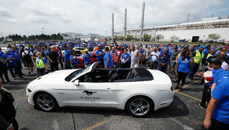 Employees surround the 10 millionth Ford Mustang ever produced during a celebration to mark the event (AFP Photo/JEFF KOWALSKY)