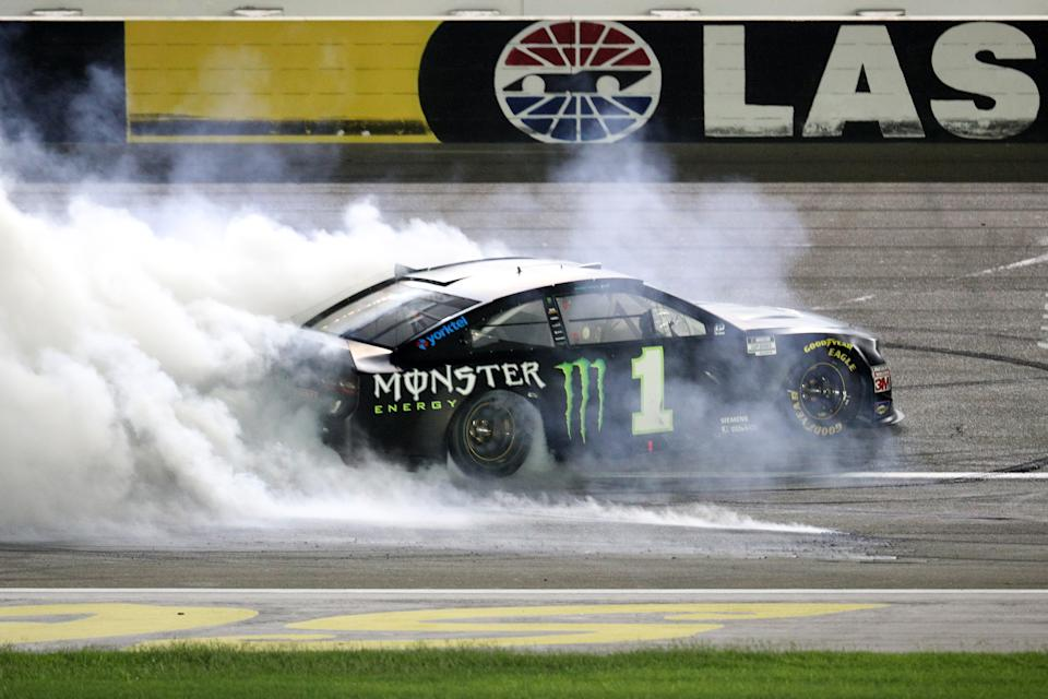 Kurt Busch celebrates with a burnout after winning the NASCAR Cup Series South Point 400 at Las Vegas Motor Speedway.