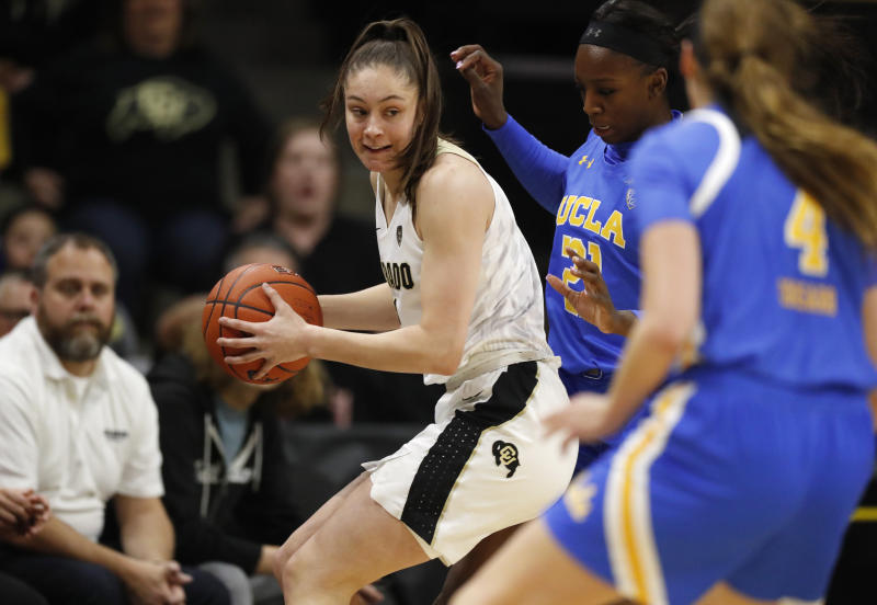 Colorado guard Emma Clarke, left, is trapped with the ball by UCLA forward Michaela Onyenwere, back right, and guard Lindsey Corsaro in the first half of an NCAA college basketball game Sunday, Jan. 12, 2020, in Boulder, Colo. (AP Photo/David Zalubowski)