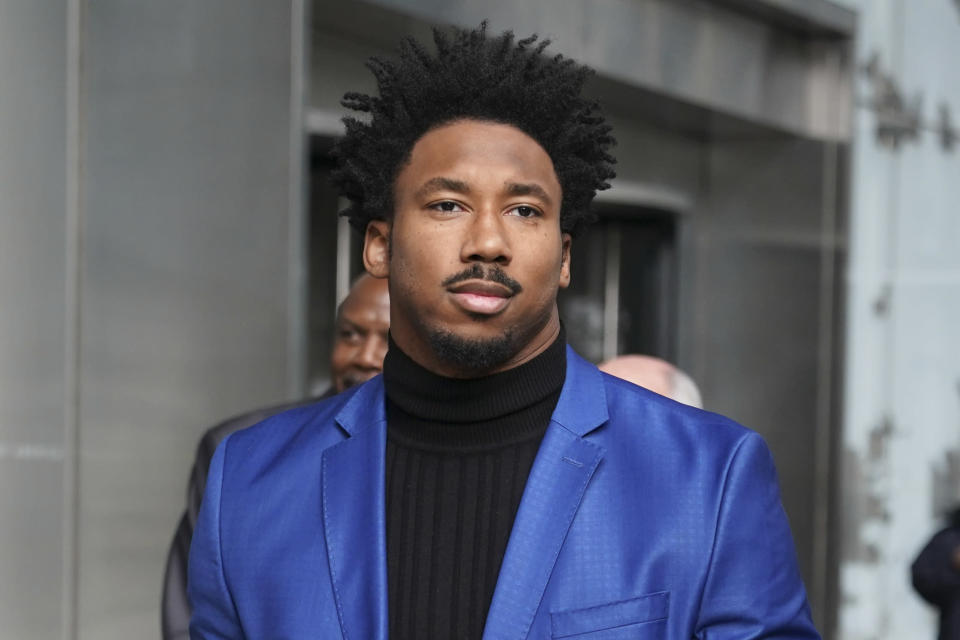 Cleveland Browns star defensive end Myles Garrett leaves an office building in New York, Wednesday, Nov. 20, 2019. Garrett is in New York for an appeals hearing to try to get the NFL to reduce an indefinite suspension that has temporarily ended Garretts season and tarnished his career. Garrett was banned last week for the rest of the regular season and playoffs for violently striking Pittsburgh quarterback Mason Rudolph with a helmet. (AP Photo/Seth Wenig)