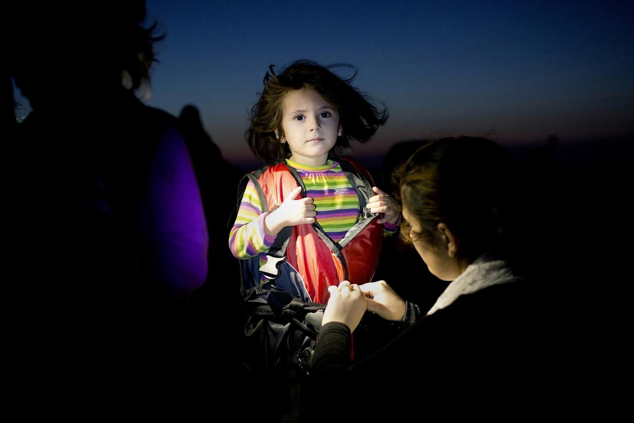 <p>A little girl arrives in Greece as a refugee after making the perilous sea journey from the Middle East. (Angelos Tzortzinis/SWPA) </p>