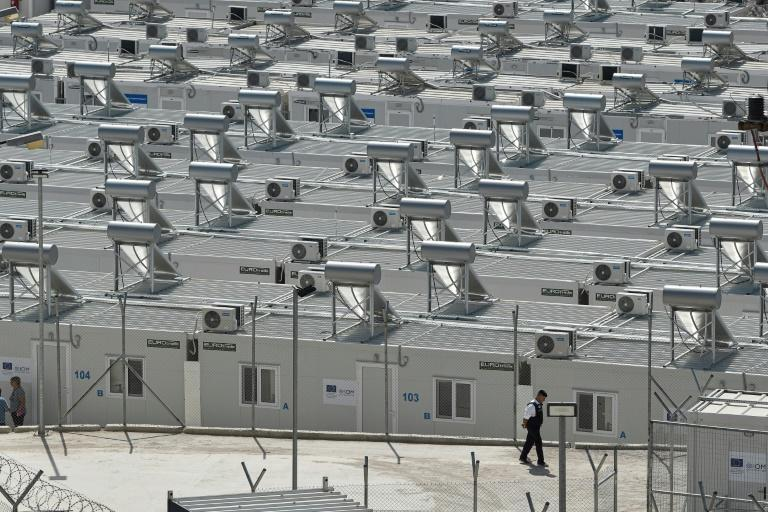 Dormitories in the new camp have five beds each and a cupboard, with shared toilets and showers (AFP/LOUISA GOULIAMAKI)