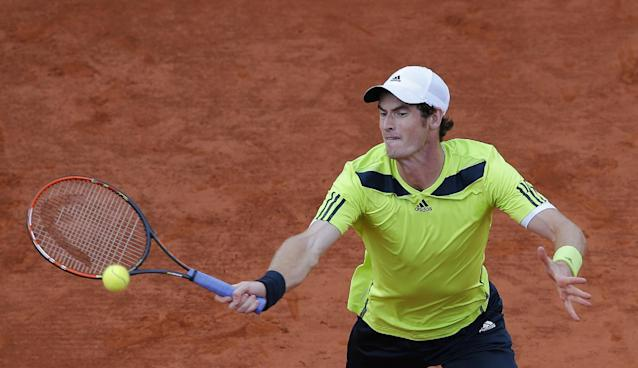 Britain's Andy Murray volleys the ball to France's Gael Monfils during their quarterfinal match of the French Open tennis tournament at the Roland Garros stadium, in Paris, France, Wednesday, June 4, 2014. (AP Photo/David Vincent)