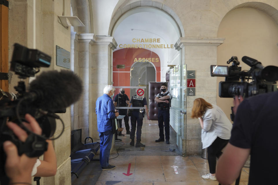 Reporters wait outside the courtroom as the 28-year-old man who slapped French President Emmanuel Macron is tried, facing possible jail time and a fine if found guilty of assaulting a public official, Thursday, June 10, 2021 in Valence, central France. Damien Tarel was quickly arrested after the swipe Tuesday that caught Macron in the face with an audible thwack as the French leader was greeting a crowd in southeast France. (AP Photo/Laurent Cirpriani)