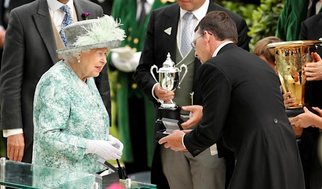 Horse Racing - Royal Ascot - Ascot Racecourse, Ascot, Britain - June 23, 2018 Britain's Queen Elizabeth presents a trophy for the 4.20 Diamond Jubilee Stakes to the trainer of Merchant Navy, Aidan O'Brien Action Images via Reuters/Andrew Boyers