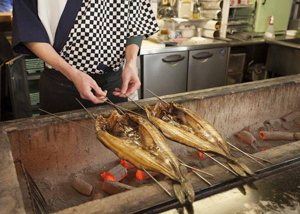 Fish being grilled inside the shop