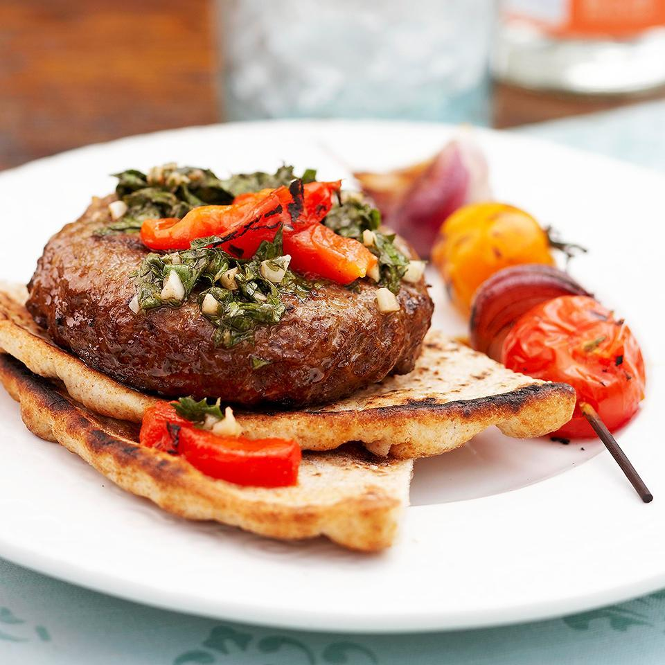 <p>These seasoned ground beef and pork burgers are topped with a fresh herb sauce and served in a pita. Quick and easy, you can make them in just 30 minutes.</p>