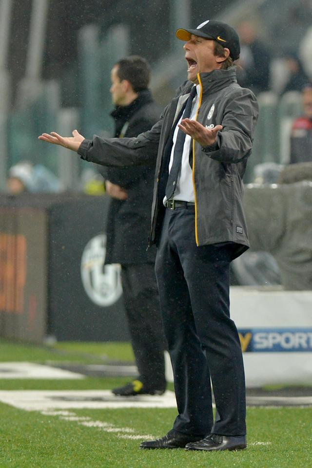 Juventus coach Antonio Conte shouts during a Serie A soccer match between Juventus and Bologna at the Juventus stadium, in Turin, Italy, Saturday, April 19, 2014. (AP Photo/Massimo Pinca)