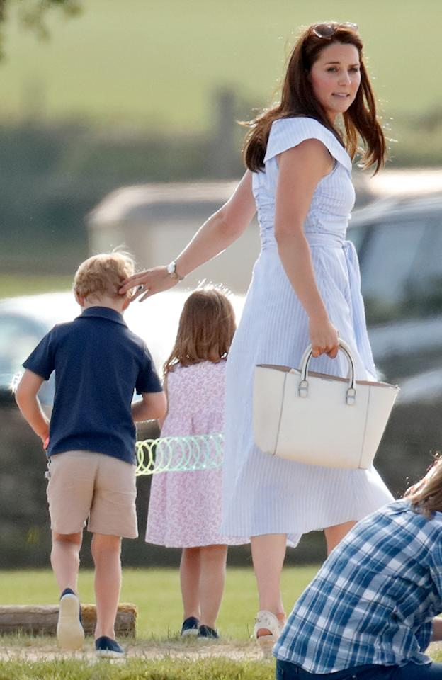 <p>For a day out at the Maserati Royal Charity Polo Trophy at the Beaufort Polo Club with her children, the Duchess of Cambridge kept cool in a £39.99 Zara dress. <em>[Photo: Getty]</em> </p>
