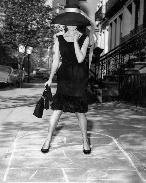 <p>October 1961 saw the release of <em>Breakfast at Tiffany's</em>, thus revolutionizing the little black dress for any season. Audrey Hepburn dons the iconic LBD for one of the film's promotional photos.</p>