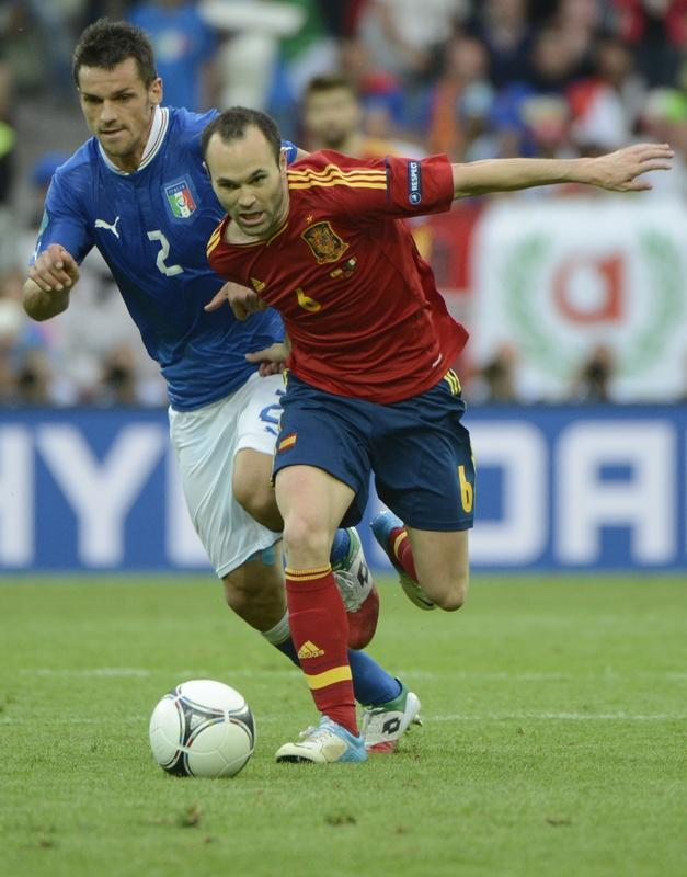 Spanish midfielder Andres Iniesta (R) vies with Italian defender Christian Maggio during the Euro 2012 championships football match Spain vs Italy on June 10, 2012 at the Gdansk Arena. AFP PHOTO / PIERRE-PHILIPPE MARCOUPIERRE-PHILIPPE MARCOU/AFP/GettyImages