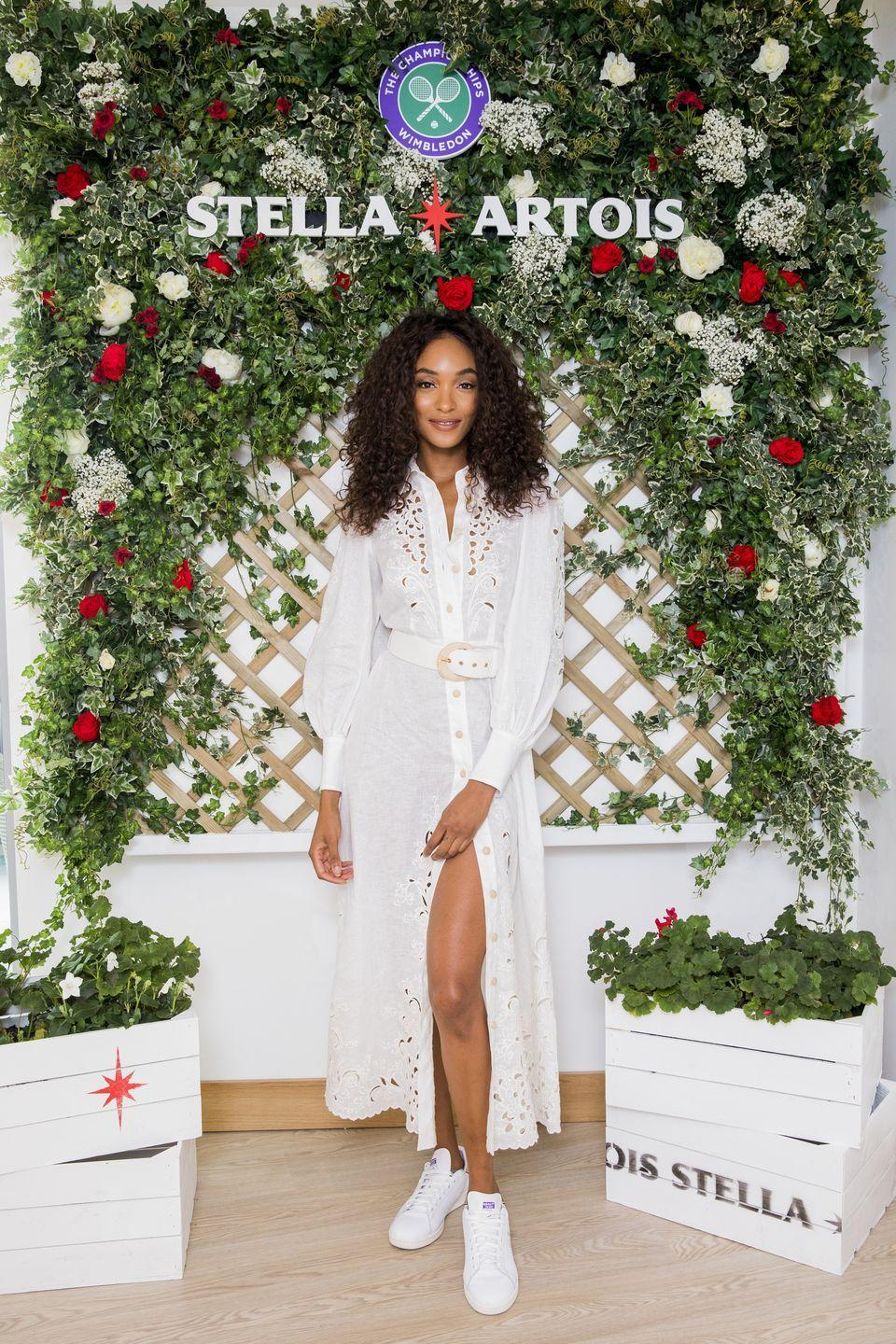 <p>The model attended the Ladies Singles Final wearing a white midi shirt dress and trainers.</p>