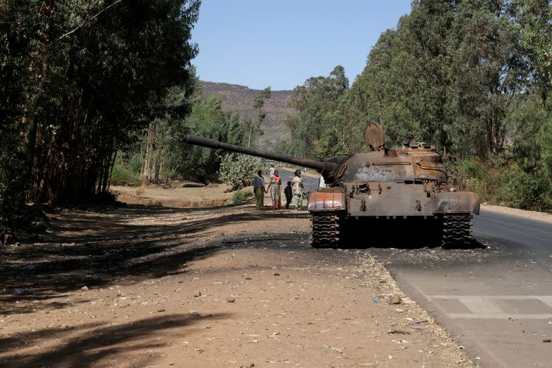 FILE PHOTO: FILE PHOTO: A burned tank stands near the town of Adwa, Tigray region, Ethiopia.