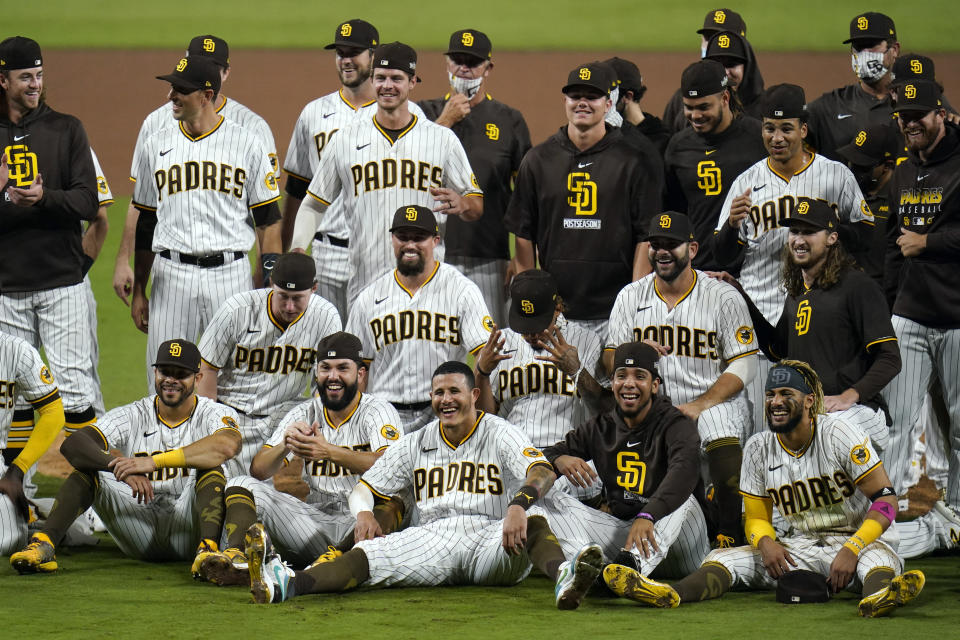 San Diego Padres pose for a photo after defeating the St. Louis Cardinals 4-0 in Game 3 of a National League wild-card baseball series Friday, Oct. 2, 2020, in San Diego. The Padres advanced to the NL Division Series. (AP Photo/Gregory Bull)