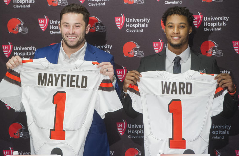 Cleveland Browns first-round draftees Baker Mayfield and Denzel Ward hold their jerseys at a news conference. (AP)