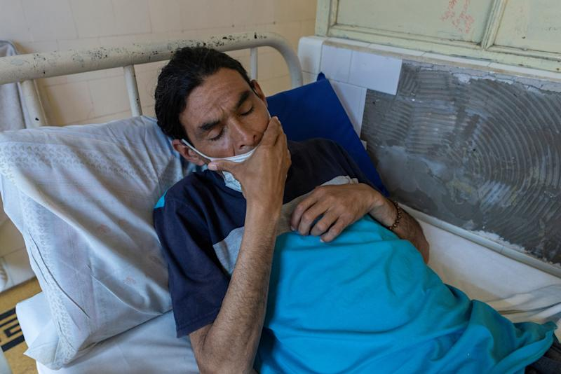 Luis Barraga, 40, who has tuberculosis, waits for his lunch to be served in his hospital room at the Muniz public hospital in Buenos Aires, Argentina, Oct. 8, 2019. Luis was living on the street when he was admitted, weighing 45kg. In the two weeks that he had been there, his weight had increased to 60kg. (Photo: Magali Druscovich/Reuters)