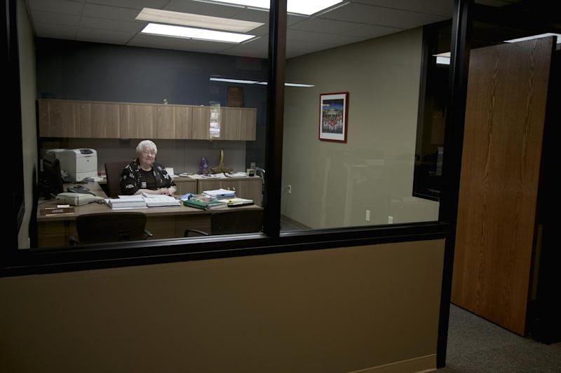"In this photo taken Aug. 1, 2012, Janice Durflinger poses for a photo at her workplace in Lincoln, Neb. Durflinger runs computer software programs for a bank. She says she still works at 76, ""because I have to."" Despite Social Security's long-term problems, the massive retirement and disability program could be preserved for generations to come with modest but politically difficult changes to benefits, taxes or a combination of both. (AP Photo/Nati Harnik)"