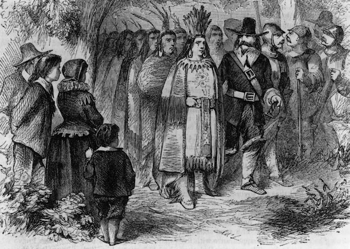 Circa 1621, Massasoit or Ousamequin, chief of the Wampanoag of Massachusetts and Rhode Island pays a friendly visit to the Pilgrims' camp at Plymouth Colony with his warriors after signing the earliest recorded treaty in New England with Governor Jo