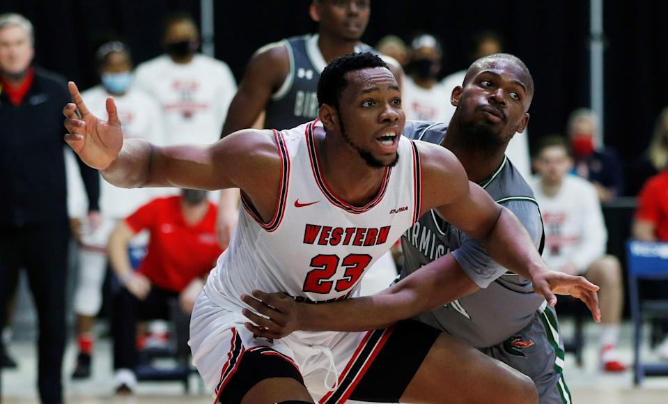 Mar 12, 2021; Frisco, Texas, USA; Western Kentucky Hilltoppers center Charles Bassey (23) is guarded by UAB Blazers forward Simeon Kirkland (10) during the second half at Ford Center at The Star. Mandatory Credit: Tim Heitman-USA TODAY Sports ORG XMIT: IMAGN-447011 ORIG FILE ID:  20210312_neb_sh2_045.JPG