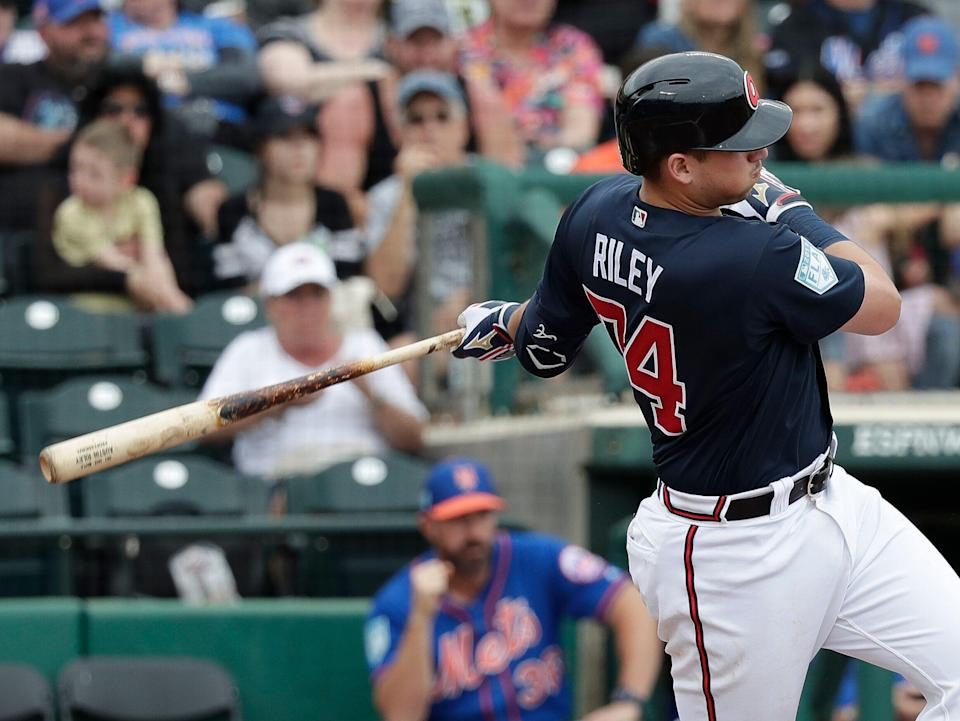 Atlanta Braves' Austin Riley hits an RBI single against the New York Mets in the sixth inning of a spring baseball exhibition game, Tuesday, Feb. 26, 2019, in Kissimmee, Fla. (AP Photo/John Raoux)