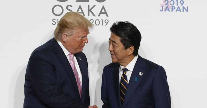 Donald Trump welcomed by Shinzo Abe at the G20 summit in Osaka, Japan.