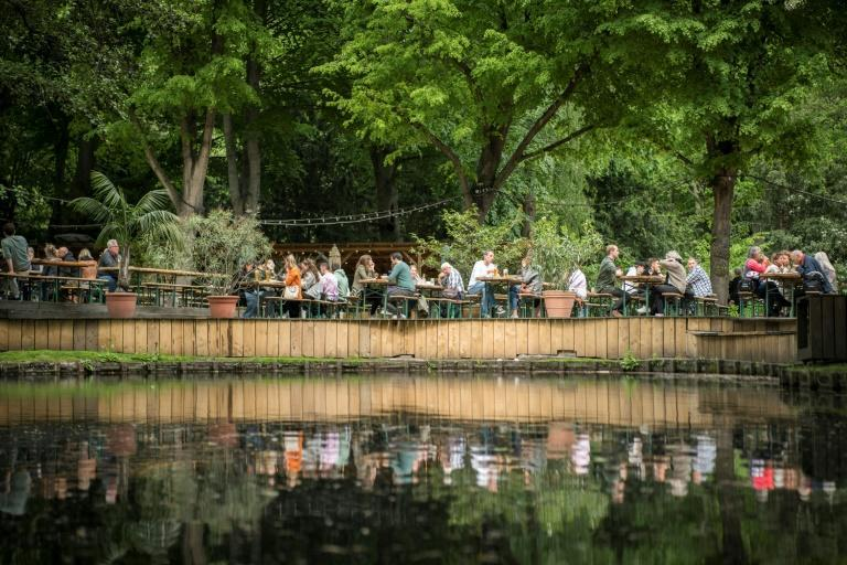 People enjoy sunny weather at a beer garden in Berlin on May 21, 2021