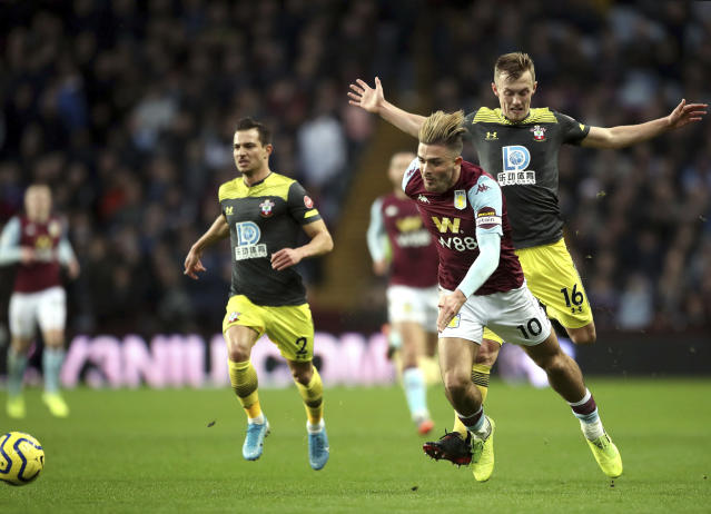 Aston Villa's Jack Grealish foreground, wins the ball from Southampton's James Ward-Prowse, during their English Premier League soccer match at Villa Park, in Birmingham, England, Saturday, Dec. 21, 2019.(Nick Potts/PA via AP)