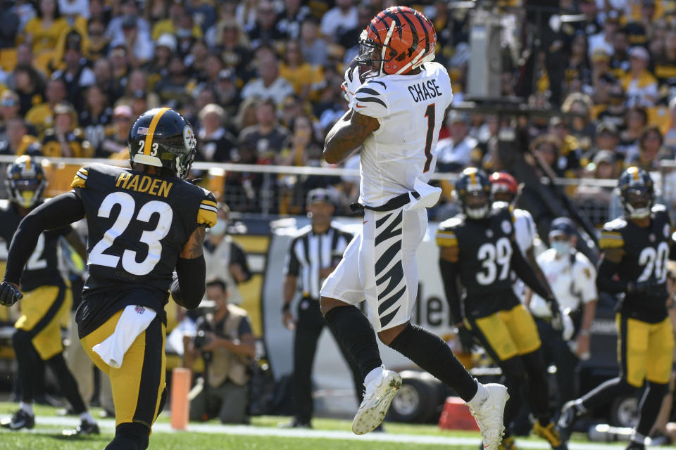 Cincinnati Bengals wide receiver Ja'Marr Chase (1) makes a touchdown catch in front of Pittsburgh Steelers cornerback Joe Haden (23) during the second half an NFL football game, Sunday, Sept. 26, 2021, in Pittsburgh. (AP Photo/Don Wright)