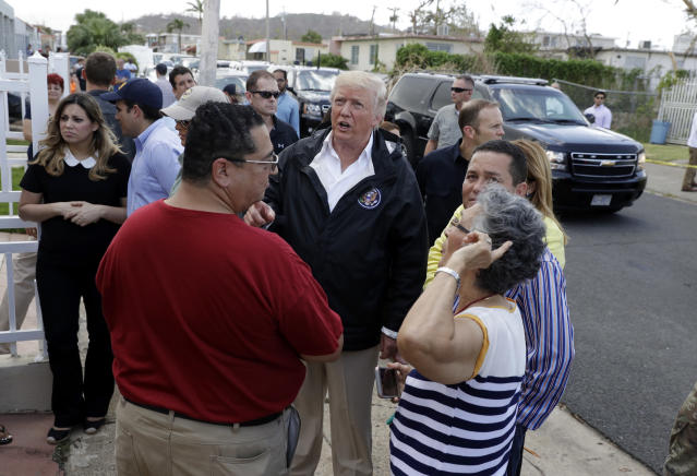 <p>President Donald Trump talks to residents while taking a walking tour to survey hurricane damage and recovery efforts in a neighborhood in Guaynabo, Puerto Rico, Tuesday, Oct. 3, 2017. (Photo: Evan Vucci/AP) </p>