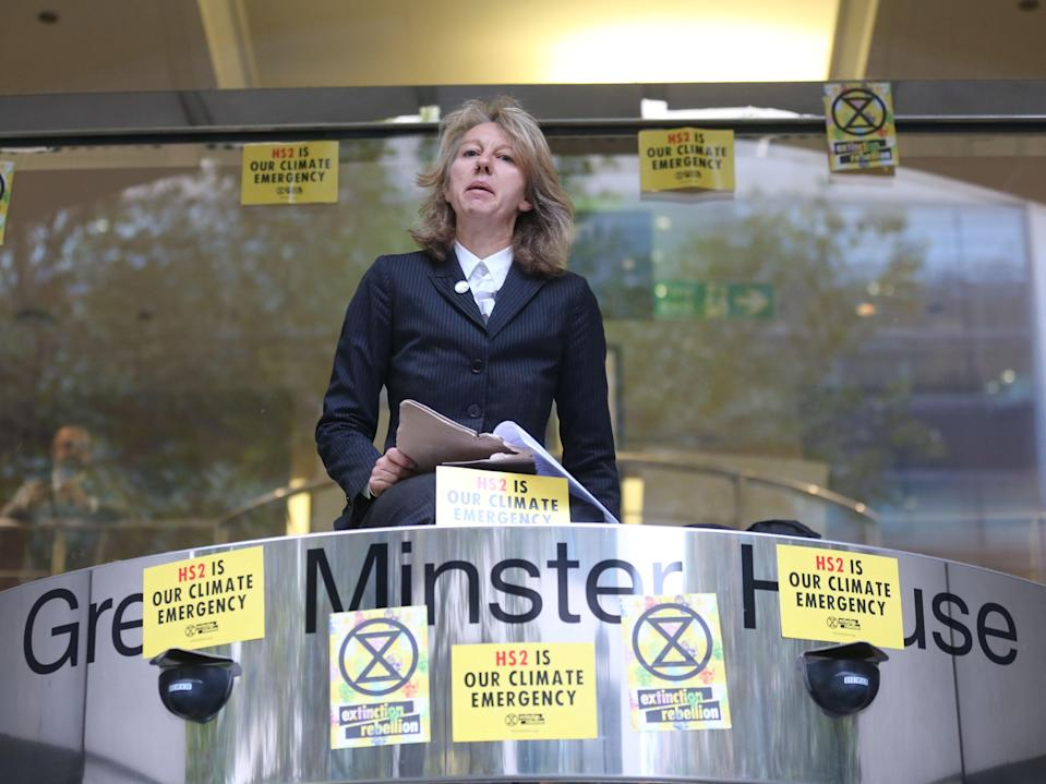Gail Bradbrook speaks before smashing a window at the building housing the Department for Transport in protest against HS2 on 15 October 2019 (AFP via Getty Images)