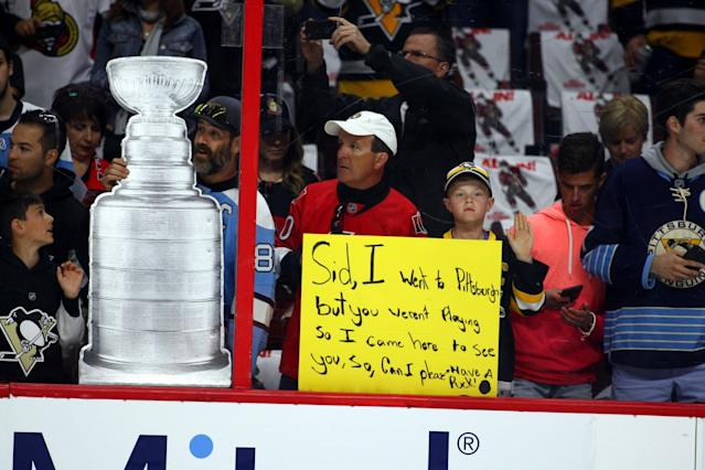 <p>A young Penguins fan with a sign for Pittsburgh Penguins Center Sidney Crosby (87) before the start of Game 4 of the Eastern Conference Finals of the 2017 NHL Stanley Cup Playoffs between the Pittsburgh Penguins and Ottawa Senators on May 19, 2017, at Canadian Tire Centre in Ottawa, On.(Photo by Jason Kopinski/Icon Sportswire via Getty Images) </p>