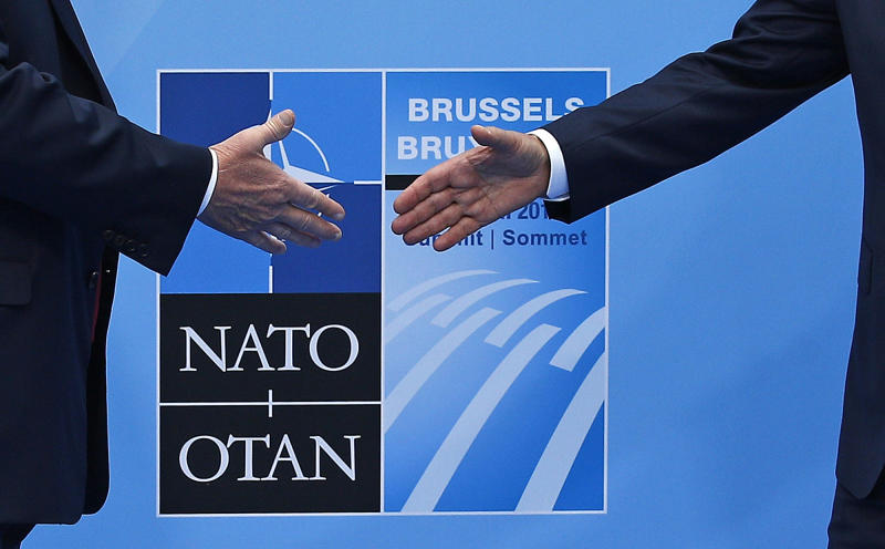 U.S. President Donald Trump, left, is greeted by NATO Secretary General Jens Stoltenberg before a summit of heads of state and government at NATO headquarters in Brussels on Wednesday, July 11, 2018. NATO leaders gather in Brussels for a two-day summit to discuss Russia, Iraq and their mission in Afghanistan. (AP Photo/Francois Mori)