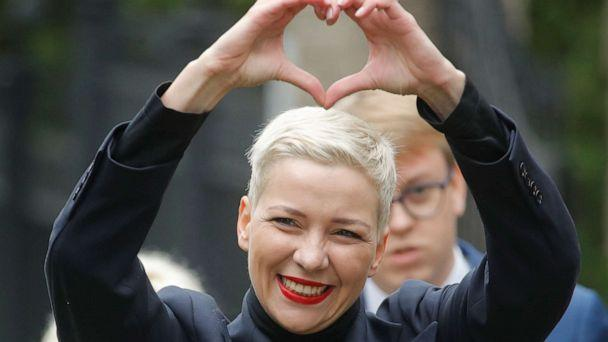PHOTO: Belarusian opposition leader Maria Kolesnikova makes a heart sign with her hands while on her way to the Belarusian Investigative Committee in Minsk, Belarus, on Aug. 27, 2020. (Dmitri Lovetsky/AP)