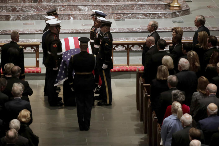 The flag-draped casket of former President George H.W. Bush is carried by a joint services military honor guard during a funeral for former President George H.W. Bush at St. Martin's Episcopal Church Thursday, Dec. 6, 2018, in Houston. (Photo: Mark Humphrey/AP)
